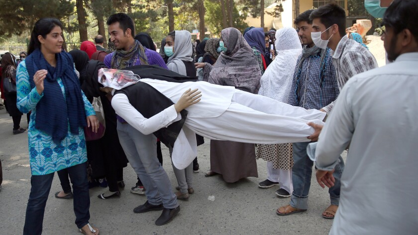 Demonstrators carry an effigy of Gulbuddin Hekmatyar at a protest in a Kabul park.