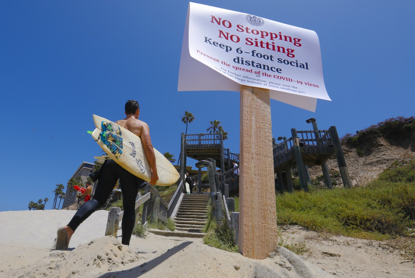 """On Saturday during the Memorial Day holiday weekend, posted signs inform the public about """"No Stopping No Sitting."""""""