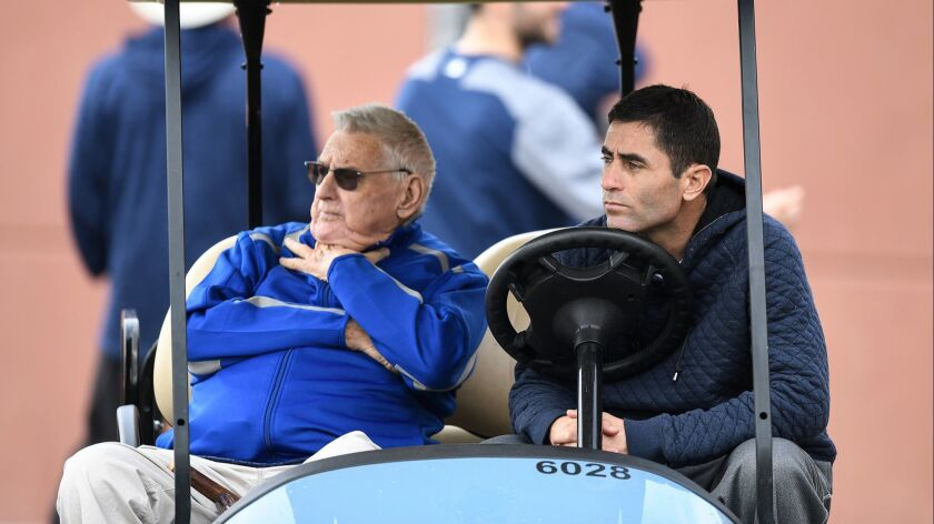 Don Welke and A.J. Preller of the San Diego Padres watch a workout at the Peoria Sports Complex on Feb. 21, 2018 in Peoria, Arizona.