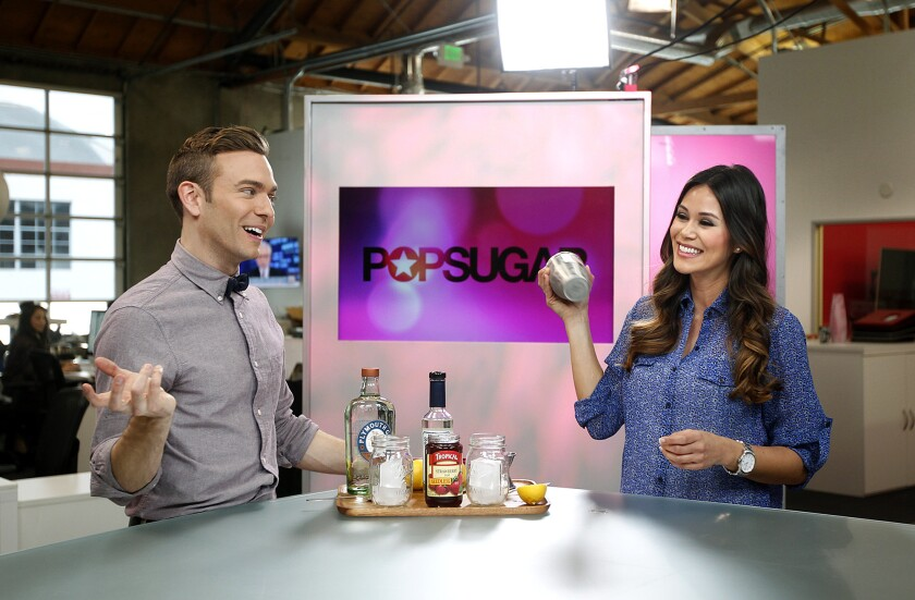 "PopSugar entertainment reporter Matthew Rodrigues, left, and lifestyle reporter Brandi Milloy make a cocktail during PopSugar's ""Happiest Hour"" segment at their studios in Culver City."