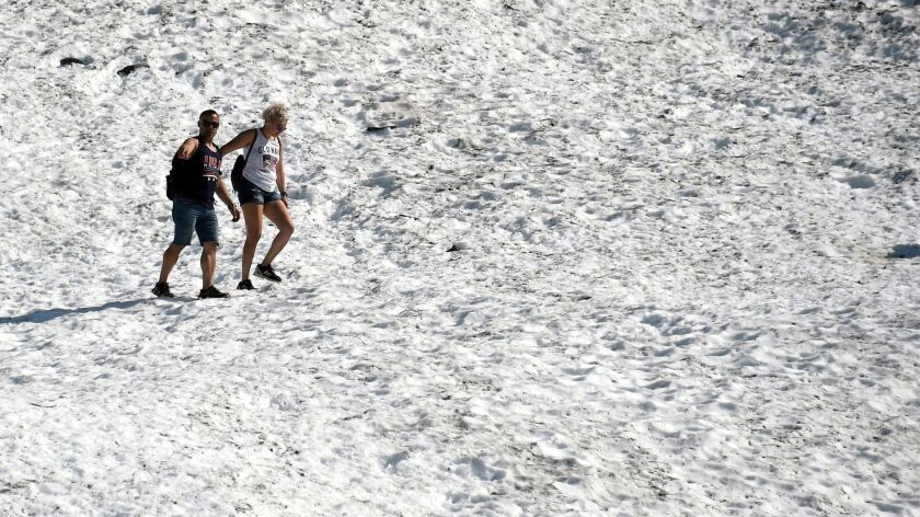 People hike on Byron Glacier in Girdwood, Alaska. Anchorage hit the 90-degree mark on Thursday, breaking a record of 85 degrees set half a century ago.