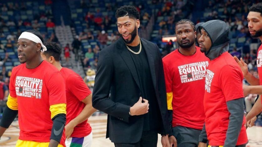 New Orleans Pelicans forward Anthony Davis huddles with teammates on the court before a game against the Indiana Pacers on Monday.