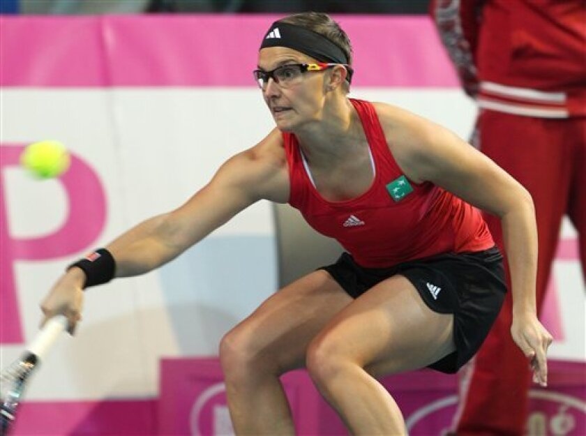 Belgium's Kirsten Flipkens returns the ball towards Serbia's Jelena Jankovic, during the World Group, first round, of the Fed Cup tennis in Charleroi, Belgium, Saturday, Feb. 4, 2012. (AP Photo/Yves Logghe)