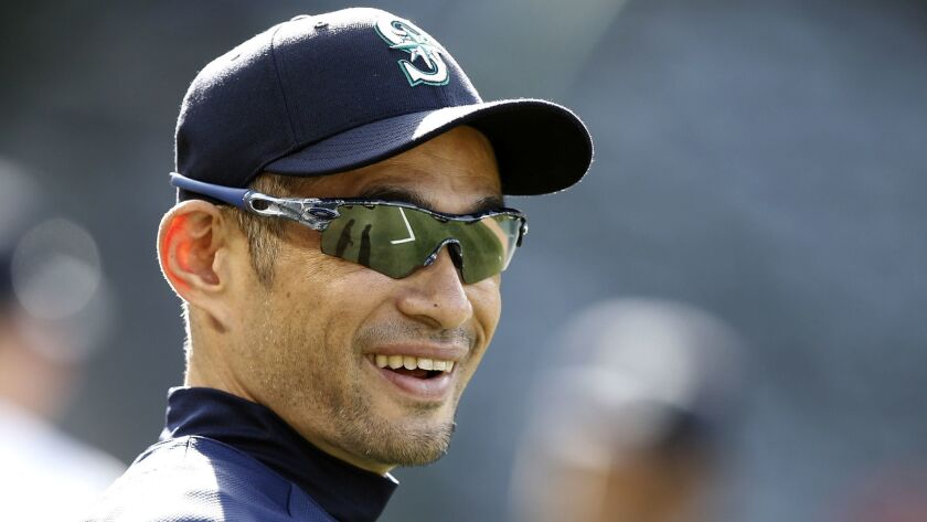 FILE - In this Tuesday, July 10, 2018 file photo, Seattle Mariners' Ichiro Suzuki, of Japan, smiles
