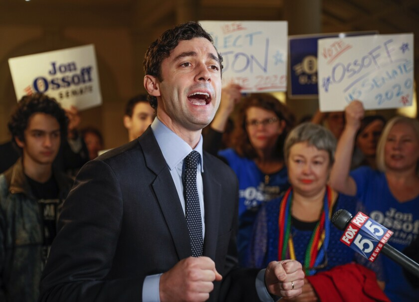 FILE - In this Wednesday, March 4, 2020, file photo, Jon Ossoff speaks to the the media and supporters after he qualified to run in the Senate race against Republican Sen. David Perdue in Atlanta. Ossoff, a young Georgia media executive known for breaking fundraising records during a 2017 special election loss for a U.S. House seat, beat back a field of Democratic primary opponents to win a spot taking on Republican Sen. David Perdue in November, according to votes tallied as of late Wednesday, June 10, 2020. (Bob Andres/Atlanta Journal-Constitution via AP, File)