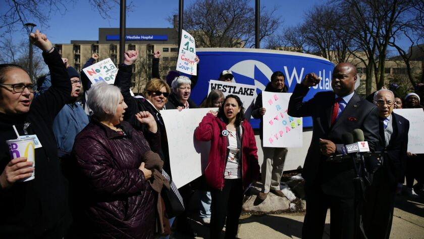 Hospital workers, community members and politicians protest against the closing of Westlake Hospital on Monday, April 15, 2019 in Melrose Park.