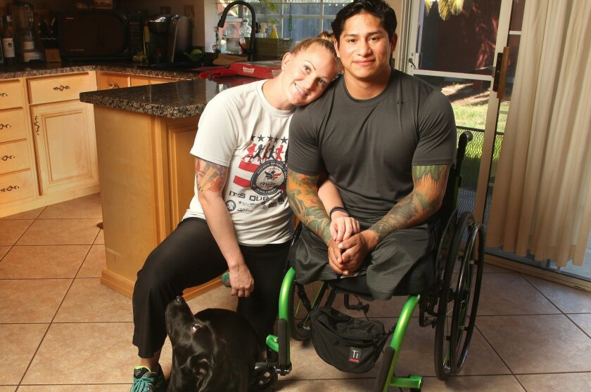 Former Marine Jorge Ortiz, right, lost both of his legs and many fingers to an IED blast in Afghanistan in 2011. While undergoing physical therapy, he met massage therapist Aiyanna Coleman, herself an Army veteran, and they fell in love. They will marry this Valentine's Day.