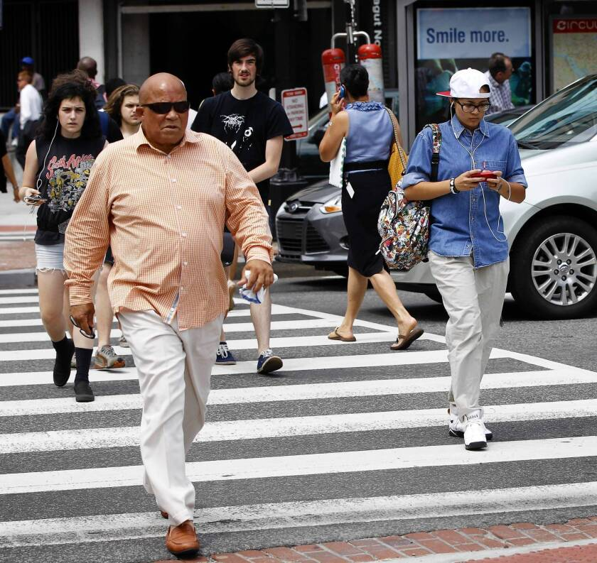 "Cities with high rates of pedestrian fatalities, which may be partially due to ""distracted walking,"" are eligible for federal grants to combat the problem."