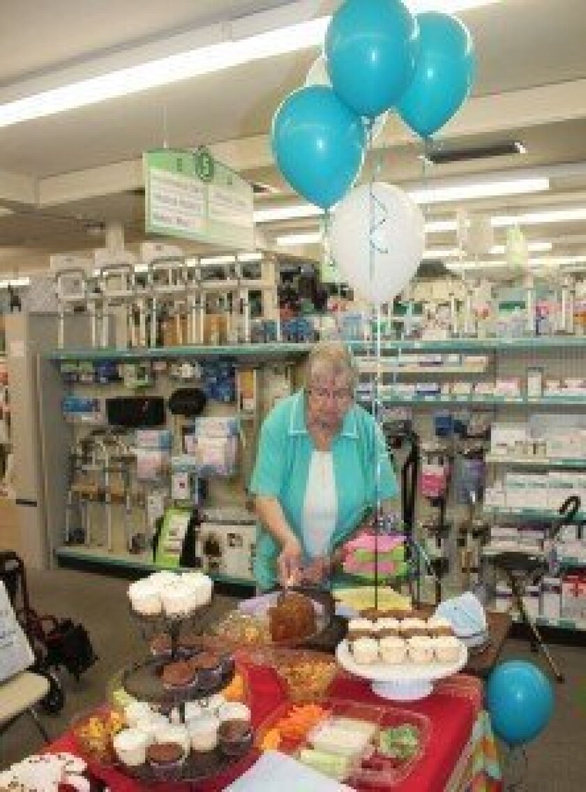 Burns Drugs offers a table of sweet treats last week in honor of Betty Clifford (pictured), 91, who retired after 19 years at the store.  Pat Sherman