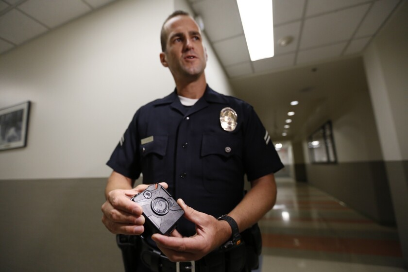 Officer Jim Stover demonstrated the use of a body camera at the LAPD's Mission Division in August.