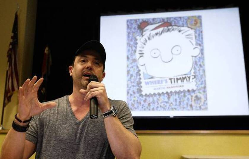 """Pearls Before Swine"" cartoonist Stephan Pastis talks to pupils at Carver Elementary School in San Marino, his alma mater, about his illustrated book, ""Timmy Failure."""