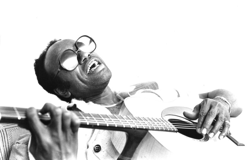 Guitarist and singer Bobby Womack plays acoustic guitar as he poses for a portrait circa 1982 in London. Womack died on Friday at 70.