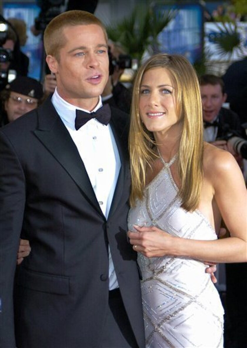 "In this May 13, 2004 file photo, Brad Pitt, left, arrives with Jennifer Aniston at the screening of his film ""Troy,""  at the 57th International Film Festival in Cannes, southern France. (AP Photo/Patrick Gardin, file)"