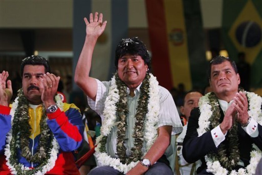 Venezuela's President Nicolas Maduro, left, Ecuador's President Rafael Correa, right, and Bolivia's President Evo Morales acknowledge supporters during a welcome ceremony for presidents attending an extraordinary meeting in Cochabamba, Bolivia, Thursday , July 4, 2013. Leaders of Uruguay, Ecuador, Surinam, Argentina and Venezuela are meeting in Bolivia Thursday in support of Morales, who said said Thursday that the rerouting of his plane in Europe, over suspicions that National Security Agency l