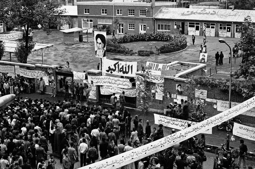 Iranians gather before the entrance of the U.S. Embassy compound in Tehran on Nov. 6, 1979