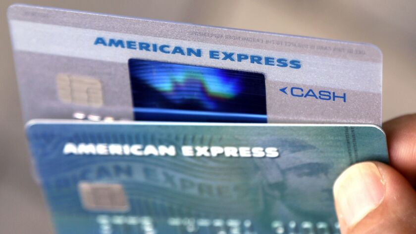 FILE - In this July 18, 2016, file photo, American Express credit cards are photographed in North An