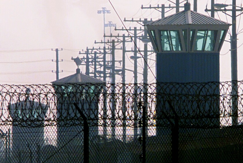 Guard towers line the western perimeter of Corcoran State Prison in Corcoran, Calif., in this 2000 photo.