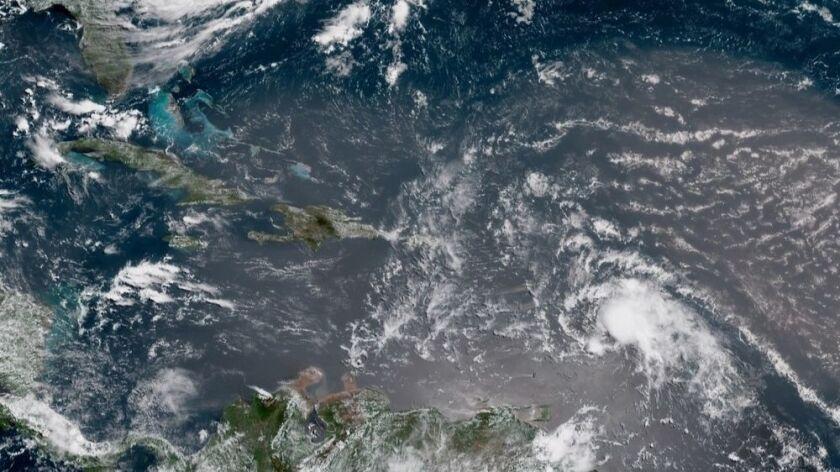 In this geocolor image GOES-16 satellite image taken Sunday, July 8, 2018, at 15:00 UTC, shows Tropi