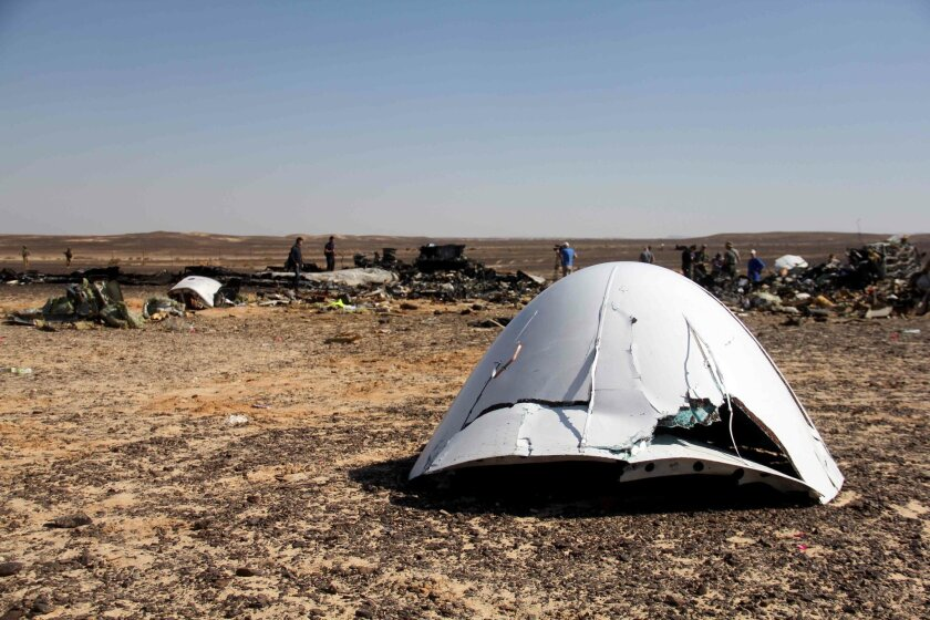 Debris of a Russian airplane is seen at the site a day after the passenger jet bound for St. Petersburg, Russia, crashed in Hassana, Egypt, on Sunday, Nov. 1, 2015. The Metrojet plane, bound for St. Petersburg in Russia, crashed 23 minutes after it took off from Egypt's Red Sea resort of Sharm el-S