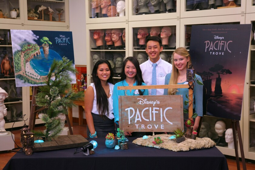 Self-proclaimed 'Disney nerds' and UC San Diego engineering students Allison Masikip, Emeline Lee, Terence Tien and Julia Soderstjerna pose with their 'Pacific Trove' project during a presentation at Walt Disney Imagineering.