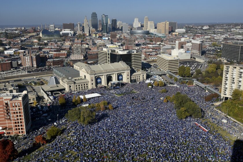 Thousands of people rally to celebrate the Kansas City Royals winning baseball's World Series Tuesday, Nov. 3, 2015, in Kansas City, Mo. The Royals beat the New York Mets in five games to win the championship. (AP Photo/Reed Hoffmann)
