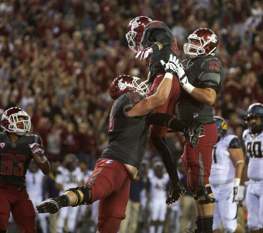 Washington State wide receiver Isiah Myers, middle, celebrates with right guard Eduardo Middleton (73) and left guard Gunnar Eklund (63) after catching a Connor Halliday pass for a touchdown during the second quarter of an NCAA college football game against California on Saturday, Oct. 4, 2014, at Martin Stadium in Pullman, Wash. (AP Photo/Dean Hare))