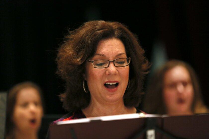 Cherylyn Larson rehearses with the San Diego Opera Chorus. Photo: Nancee E. Lewis