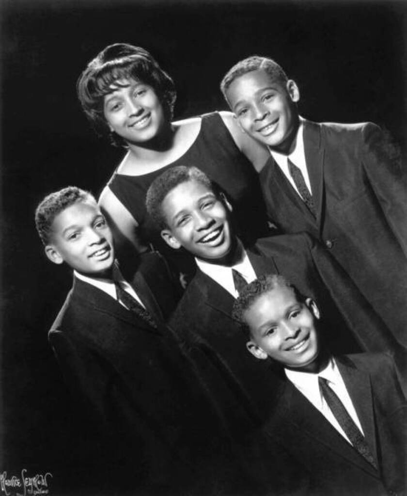 The Five Stairsteps are shown in 1966: Clarence Burke Jr., center, surrounded by his siblings, clockwise from top, Alohe, Dennis, Kenneth and James.