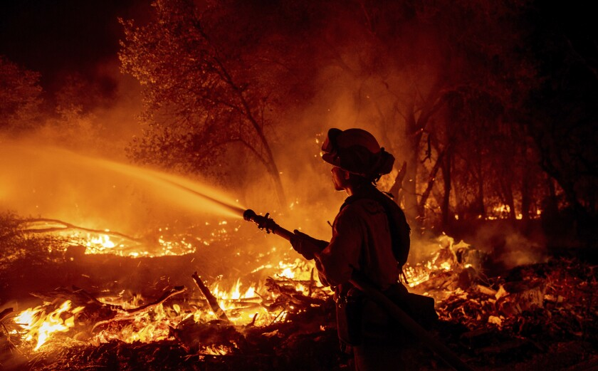 Firefighter Ron Burias battles the Fawn Fire as it spreads north of Redding, Calif. in Shasta County, on Sept. 23, 2021.