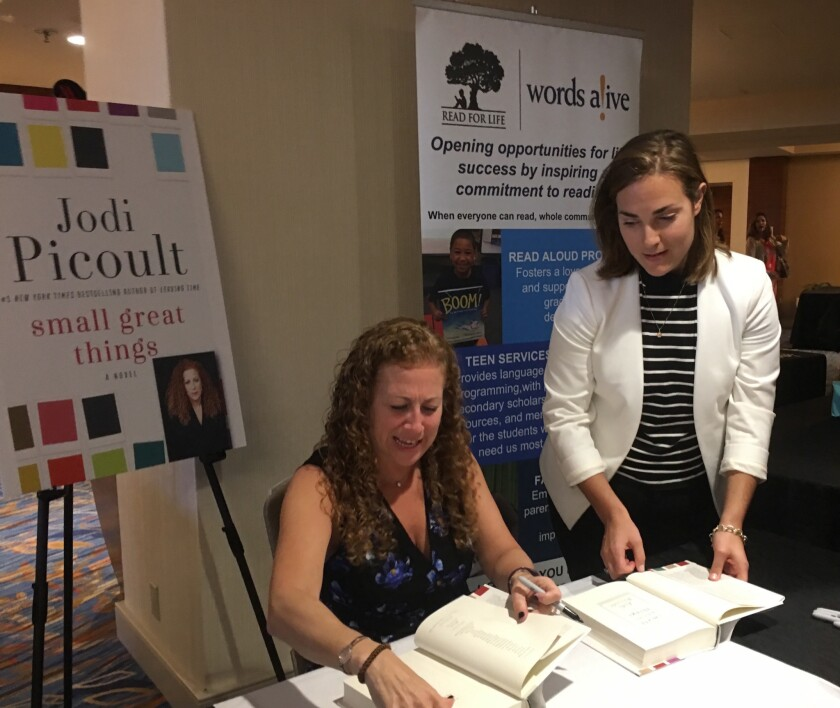 Jodi Picoult signing a book at the recent Words Alive event.