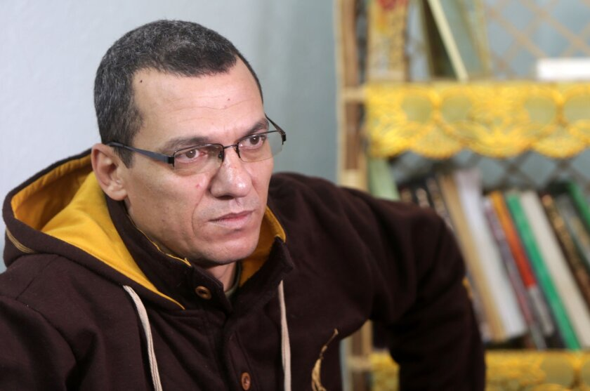 Palestinian journalist Ayman al-Aloul answers questions during an interview on Jan. 13 at his family home in Gaza City.