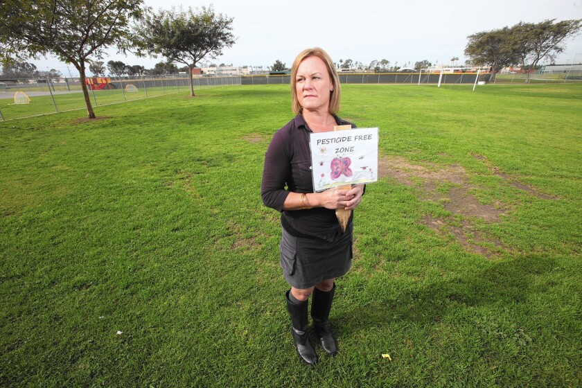 Vanessa Handy stands in the open grass area where kids play at Davis Magnet School. Davis started the anti-pesticide campaign at NMUSD and Davis is one of the schools that stopped spraying due to her efforts.