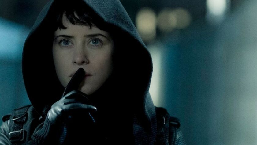 """Lisbeth Salander (Claire Foy) making her way to Balder's safe house in Columbia Pictures' """"The Girl in the Spider's Web."""""""