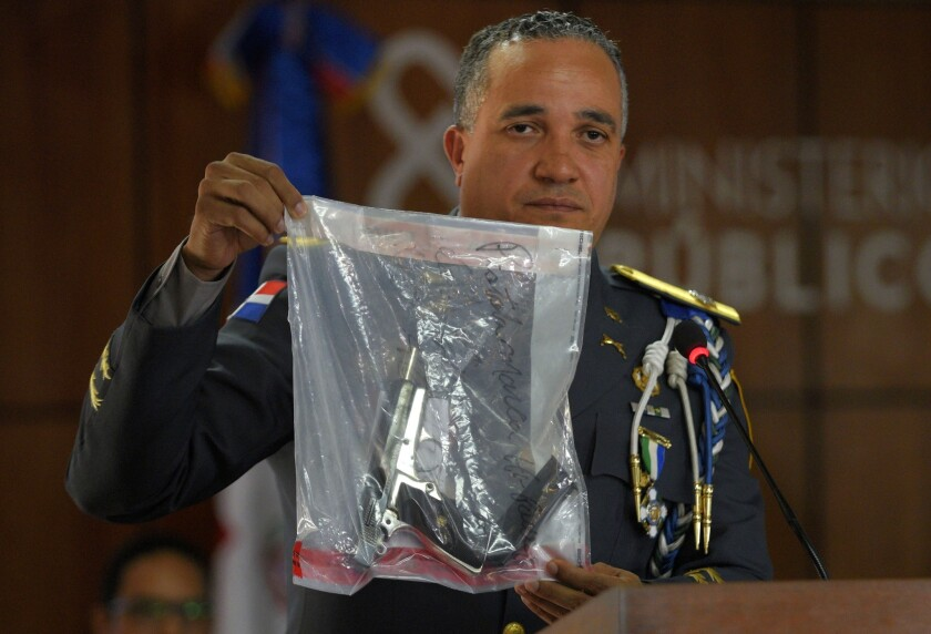 The director of the National Police, General Ney Aldrin Bautista Almonte shows the weapon that was u