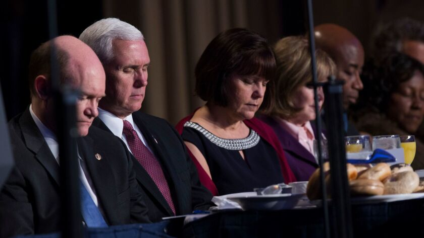 """Vice President Mike Pence and his wife Karen pray during the National Prayer Breakfast on Feb 2 in Washington, where President Trump promised to """"totally destroy"""" the Johnson Amendment."""