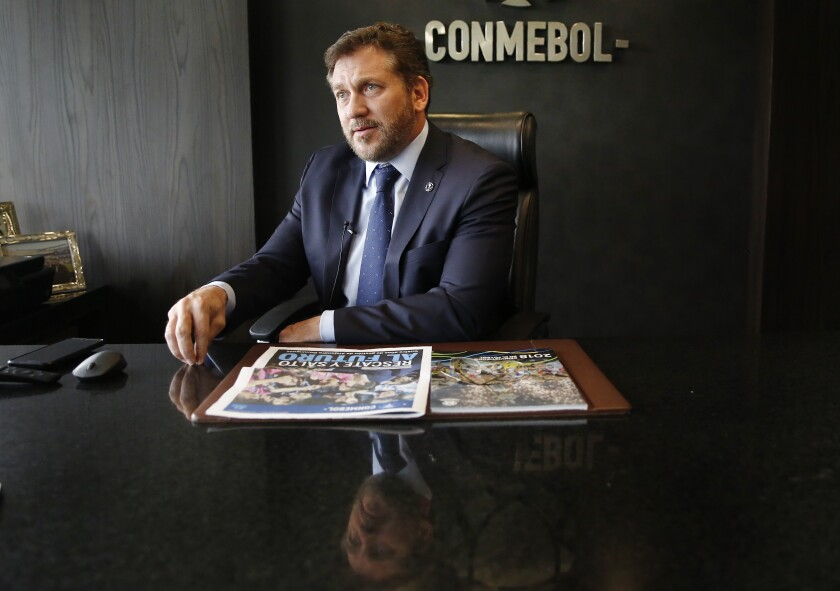 Conmebol President Alejandro Dominguez gives an interview at the soccer organization's headquarters in Luque, Paraguay, Wednesday, Feb. 19, 2020. Domínguez expressed reservations with the new format set up for the FIFA club world championship recently announced by FIFA. (AP Photo/Jorge Saenz)