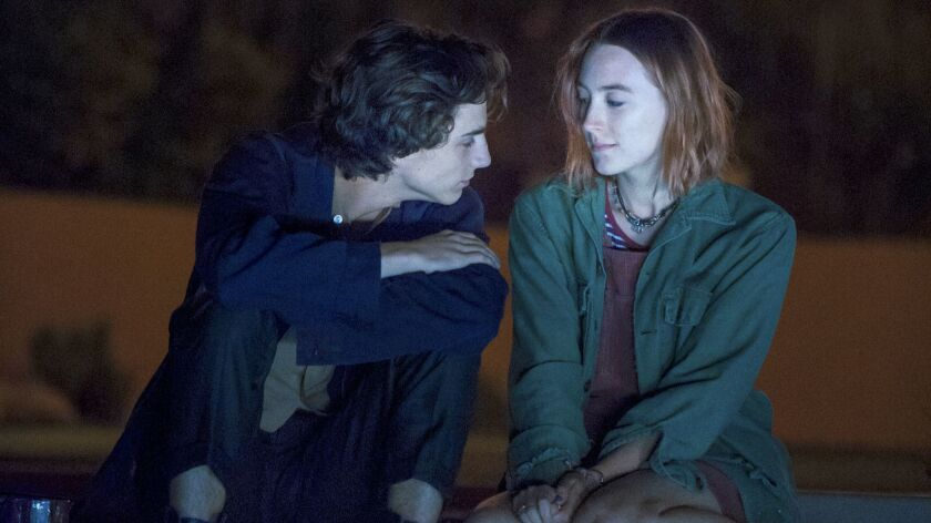 """(L-R) - Timothee Chalamet and Saoirse Ronan in a scene from the movie """"Lady Bird."""" Credit: A24"""