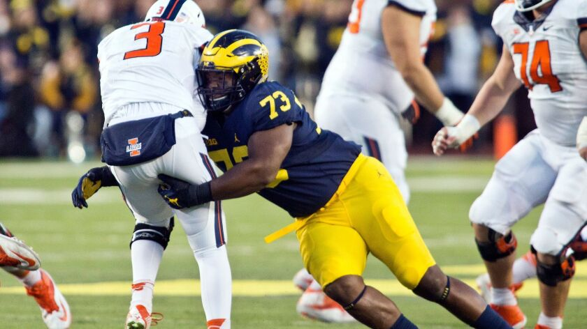 Illinois quarterback Jeff George, Jr. (3) is sacked by Michigan defensive tackle Maurice Hurst (73).