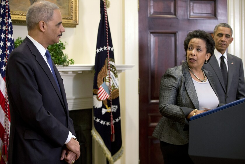 Then-Atty. Gen. Eric H. Holder Jr. with his successor, Loretta Lynch, as President Obama nominated her in 2014. Under Holder and Lynch, the Justice Department revived its civil rights division.