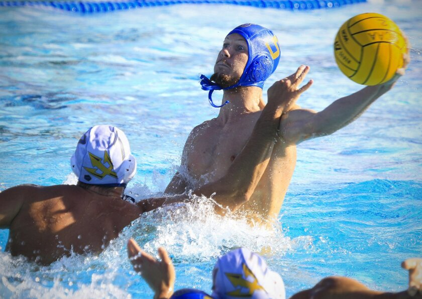UCSD's #7-Joe Dietrich and UCLA's #5-Ryder Roberts battle during the NCAA 2014 National Collegiate Men's Water Polo Championships  semifinal match at UCSD. UCLA won by a wide margin, 15-6. U-T San Diego/
