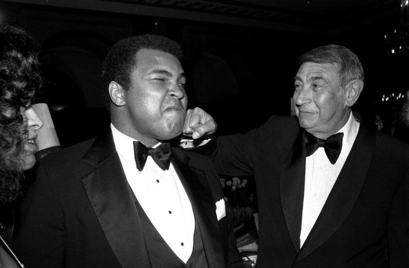FILE - In this April 13, 1981, file photo, sportscaster Howard Cosell, right, is pictured laying one on the chin of former world heavyweight boxing champ Muhammad Ali during a dinner in New York. Ali, the magnificent heavyweight champion whose fast fists and irrepressible personality transcended sp