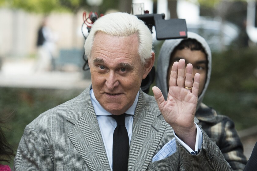 Roger Stone waves outside a federal court in Washington in November 2019.