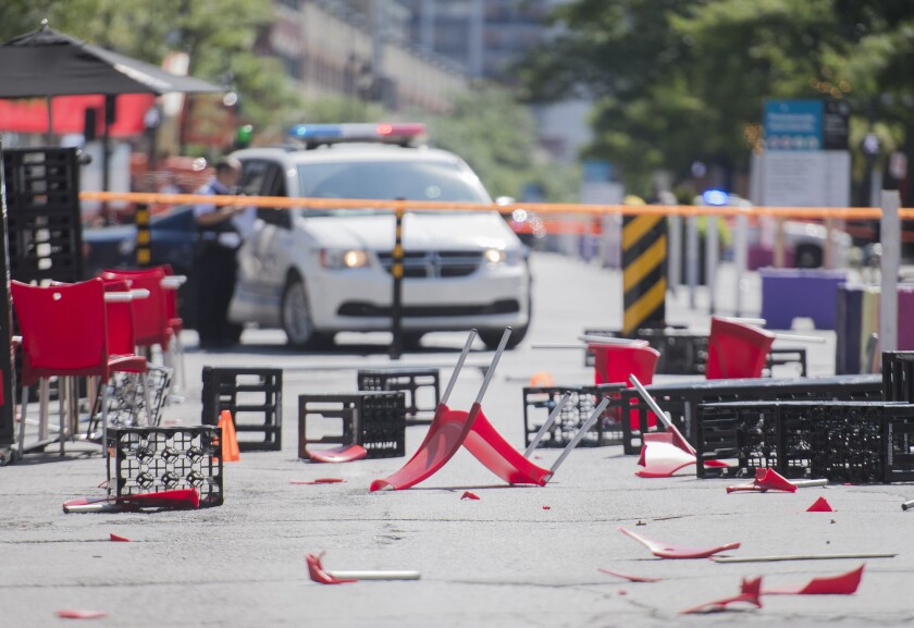 The remains of an outdoor terrace are shown after a jeep collided with it as it sped down a pedestrian zone on Sainte-Catherine Street in Montreal, Saturday, Aug. 8, 2020.