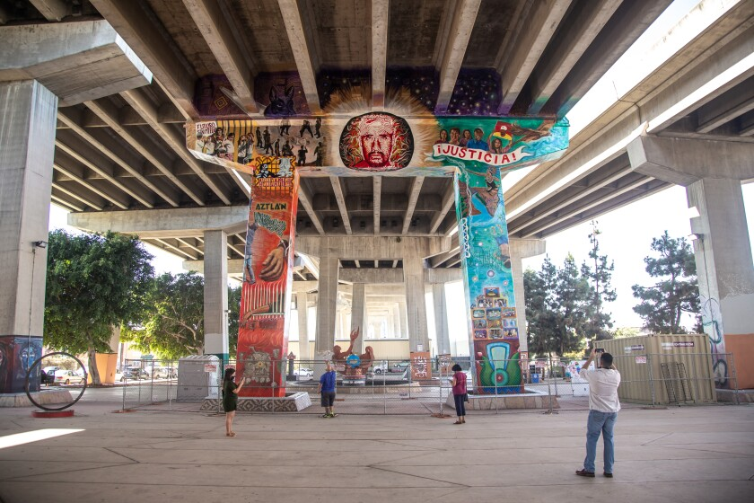A new mural in Chicano Park honors Anastasio Hernandez Rojas and immigrants who died at border.
