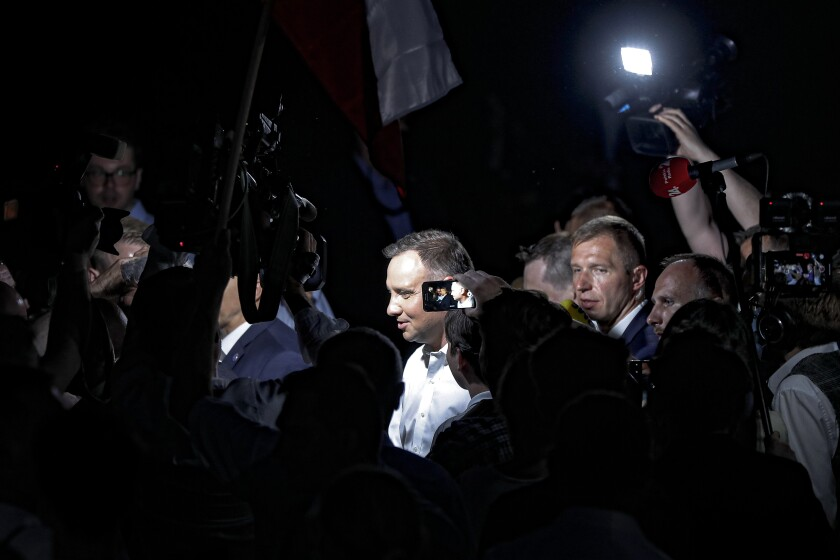 President Andrzej Duda leaves after speaking to supporters at the end of the voting in the presidential election day in Lowicz, Poland, Sunday, June 28, 2020. The election will test the popularity of incumbent President Andrzej Duda, who is seeking a second term, and of the conservative ruling party that backs him. Exit poll shows incumbent Andrzej Duda with most votes in Polish presidential vote, but short of first-round win.(AP Photo/Petr David Josek)