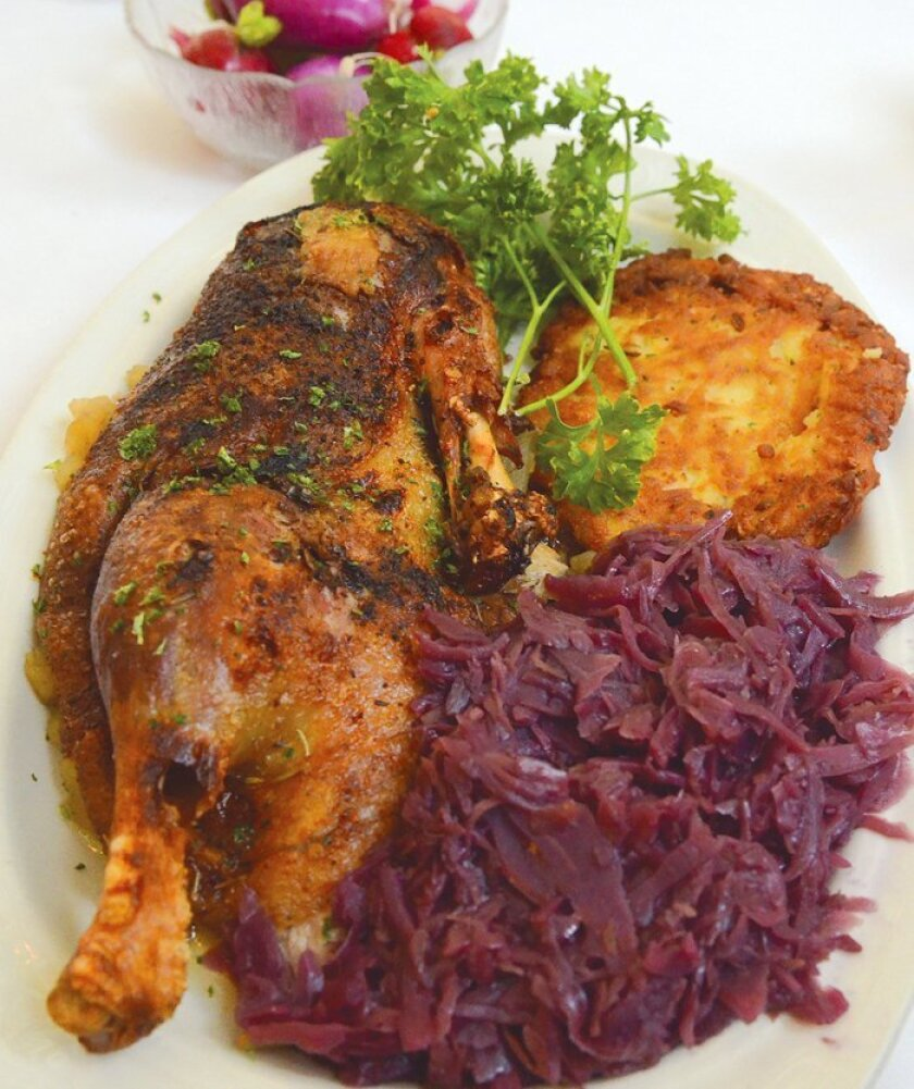 Kaiserhof Restaurant's Roast Duck can be served with Madeira sauce, apples and raisins, potato pancake and red cabbage.