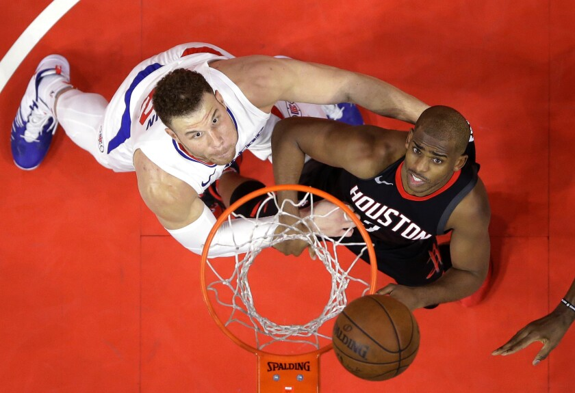 Blake Griffin and Chris Paul battle for a rebound.