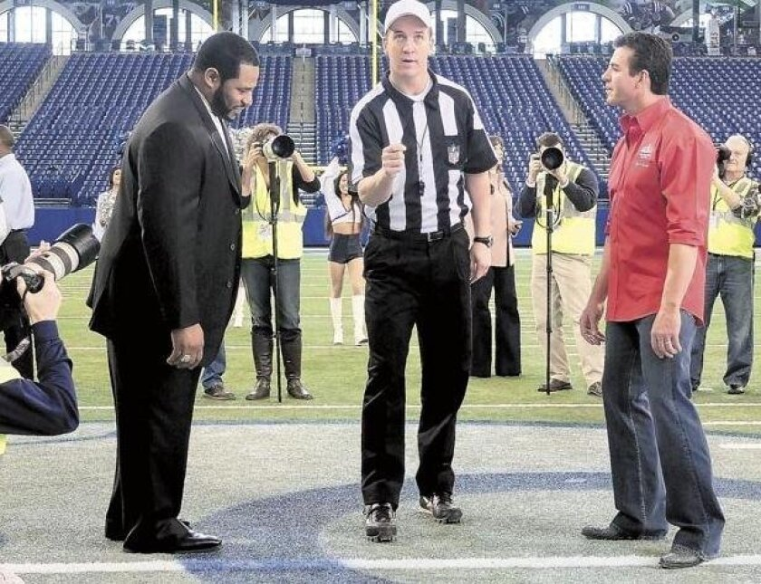 NFL stars Peyton Manning (center), Jerome Bettis (left) and Papa John's Founder, Chairman and CEO John Schnatter appear in a commercial shoot at Lucas Oil Stadium in Indianapolis for Papa John's.