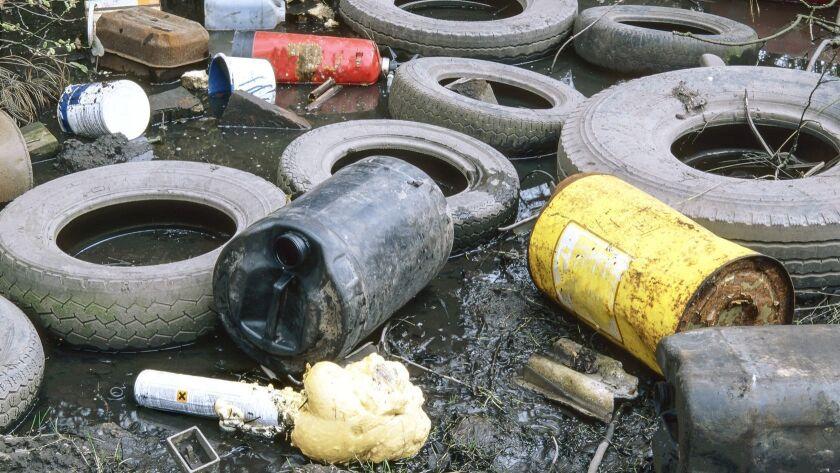 Garage waste dumped on waste ground, West Midlands, UK