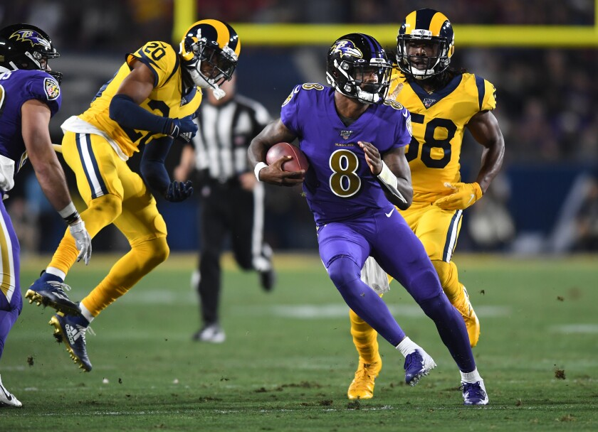 The Rams' defense could not keep up with Baltimore's Lamar Jackson (8).